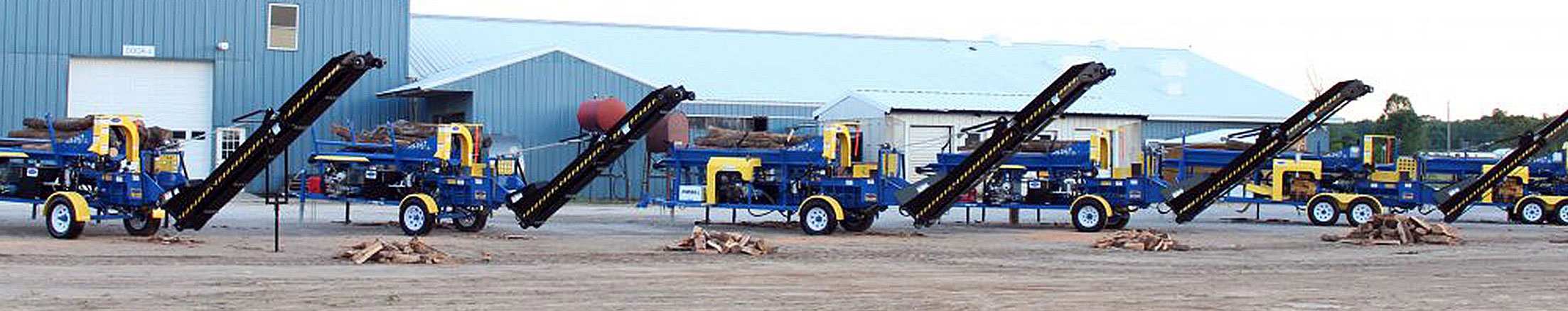 Firewood processor machines in front of DYNA
