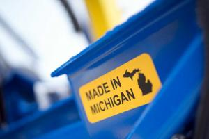 Sticker showing machine is made in Michigan