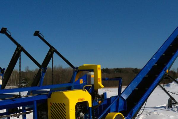 Blue DYNA Conveyor connected to firewood processor.